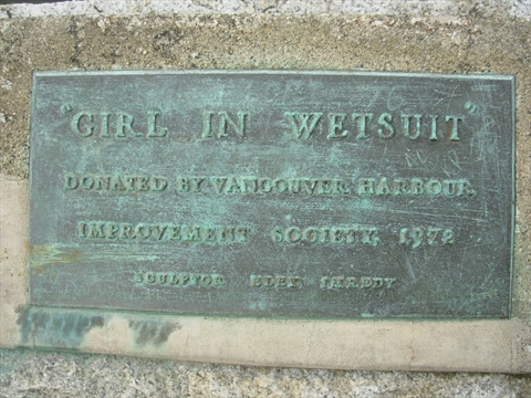 Girl in Wetsuit Statue plaque in Stanley Park, Vancouver, B.C., Canada