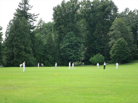 Cricket being played at Brockton Fields in Stanley Park