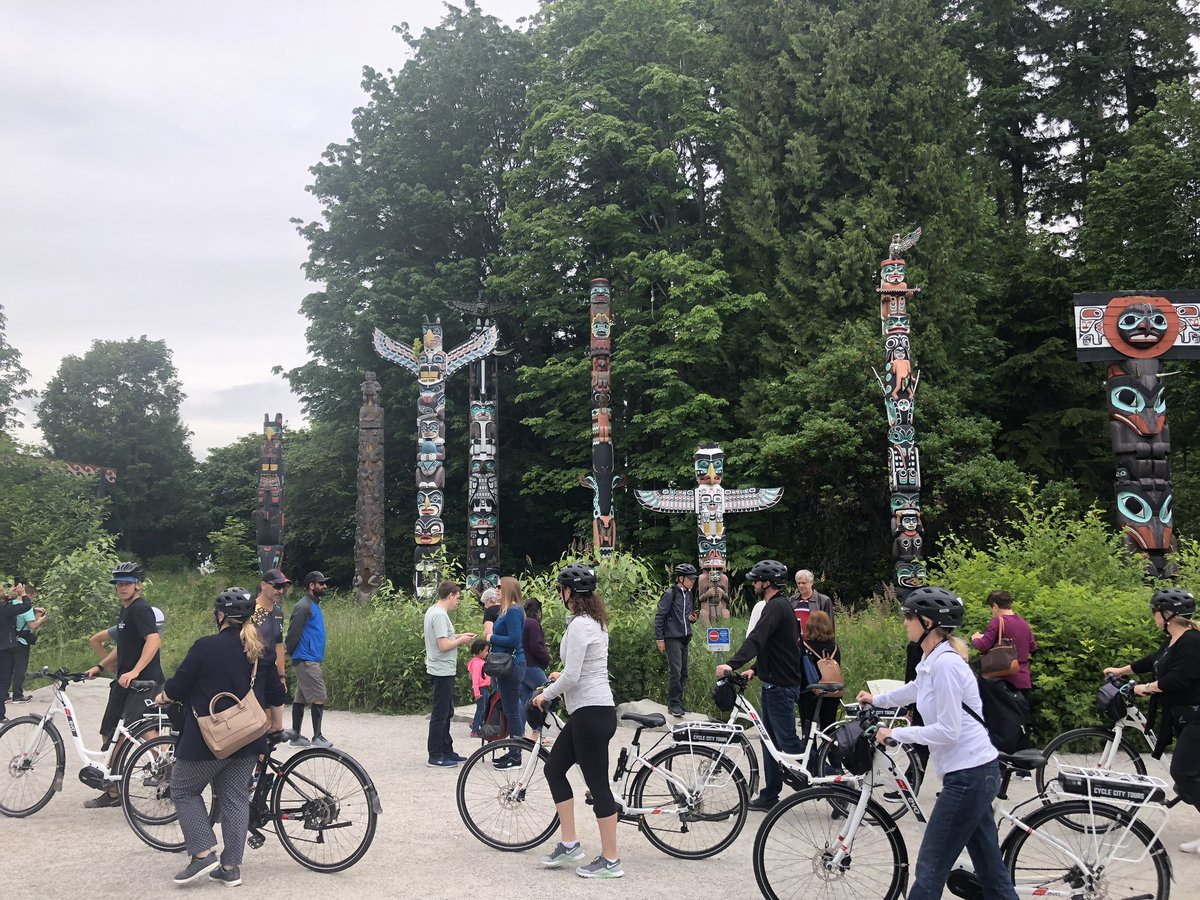 Bicycle tour at Totem Poles in Stanley Park, Vancouver, BC, Canada